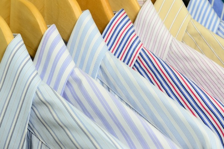 Shirts on wooden hangers Stock Photo