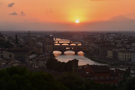 Sunset overlooking Ponte vecchio in Florence, Italy Stock Photo