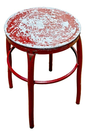 Old metal red chair on isolate white background photo