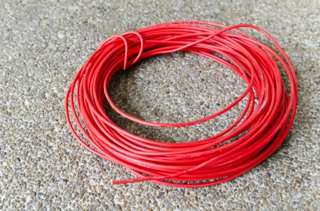 monophonic: Red hot power cable on sand floor