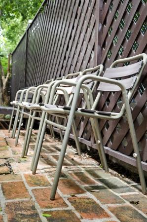 Old metal  chair on brick floor Stock Photo - 20024121