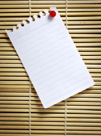 notebook paper background: memo note with red pin on wood board
