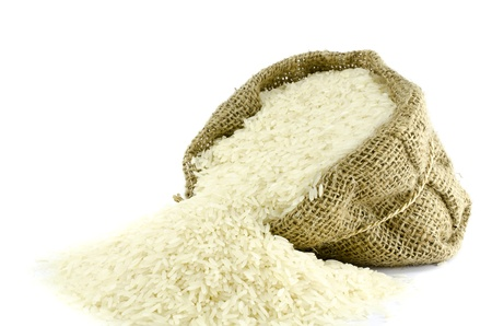 Rice in Gunny bag with white isolate background  photo