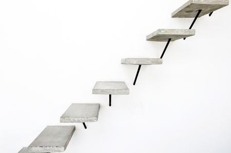 Concrete ladder on white wall background photo