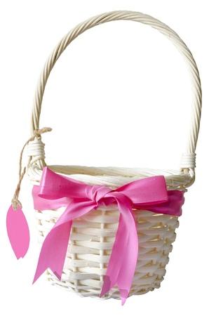 ribbin: basket with pink ribbin on white isolate background Stock Photo