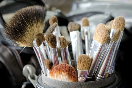 Old make-up brushes in holder photo