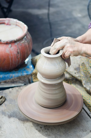 potter man hands shaping ceramic craft, Khun-Ream water market , Thailand
