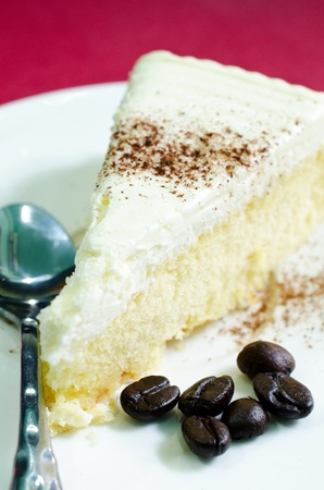 butter cake with spoon on white plate    photo