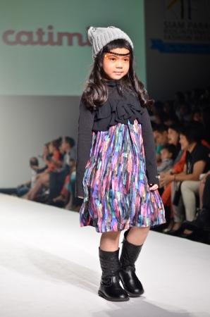 paragon: HAILAND, BANGKOK- OCT 2013   A model walks the runway at the catimini New Collection 2013 at Kids Internation Fashion Week 2013 during 5-6 october, 2013 in Bangkok,Thailand