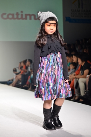 HAILAND, BANGKOK- OCT 2013   A model walks the runway at the catimini New Collection 2013 at Kids Internation Fashion Week 2013 during 5-6 october, 2013 in Bangkok,Thailand