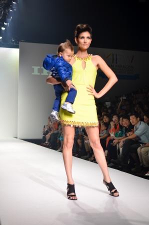 paragon: THAILAND, BANGKOK- OCT 2013 : A model walks the runway at the IKKS New Collection 2013 at Kids Internation Fashion Week 2013 during 5-6 october, 2013 in Bangkok,Thailand Editorial