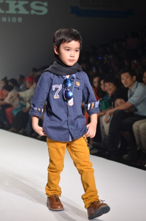 THAILAND, BANGKOK- OCT 2013 : A model walks the runway at the IKKS New Collection 2013 at Kids Internation Fashion Week 2013 during 5-6 october, 2013 in Bangkok,Thailand Editorial