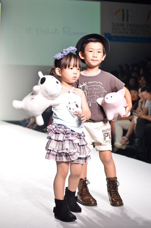 THAILAND, BANGKOK- OCT 2013 : A model walks the runway at the LE PETIT PUMM New Collection 2013 at Kids Internation Fashion Week 2013 during 5-6 october, 2013 in Bangkok,Thailand