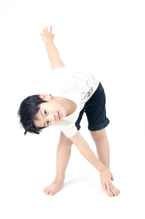 Portrait of Asian cute boy exercise on white background .