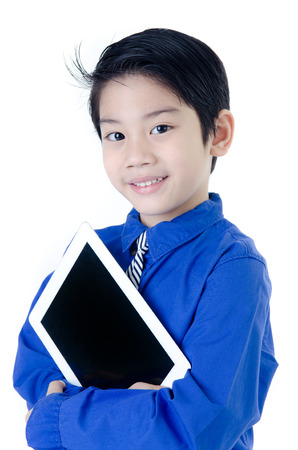 Happy Asian child with tablet computer on isolated