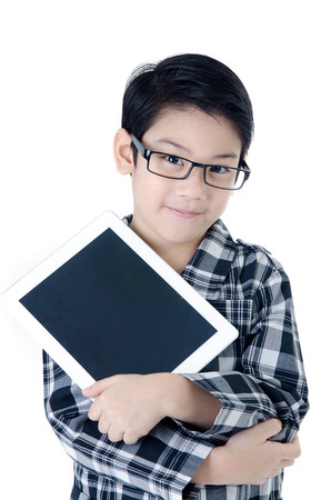 Cute asian Thailand boy with tablet computer on isolated background