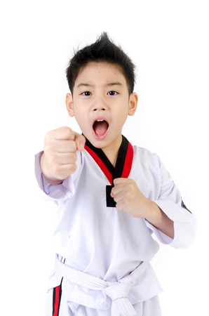 Taekwondo action  by Little asian boy smiles, isolate on white background