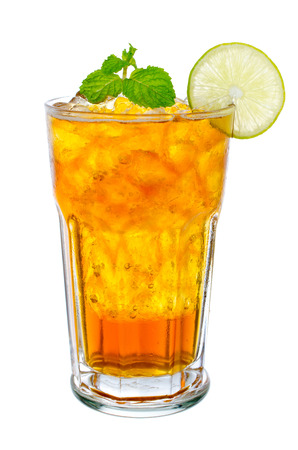 Fresh and cold ice tea with sliced lemon and mint isolated on white