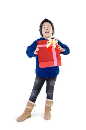 Portrait of Asian cute boy with gift box represents Christmas theme