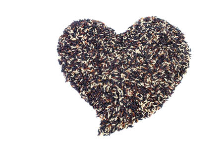 scattered in heart shaped: Mixed Pile of black Rice and white rice Shaped into a Heart .