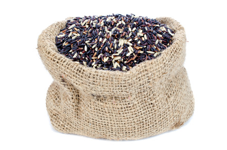 gunny bag: Black Rice pile in Gunny bag with white isolate background