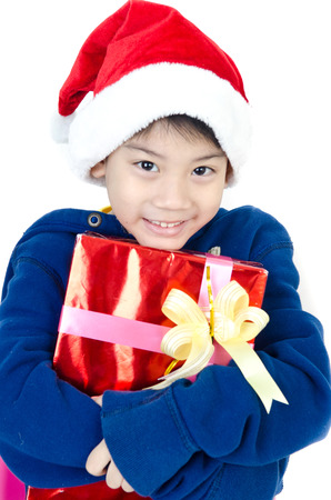 Portrait of Asian cute boy  in christmas hat .  photo
