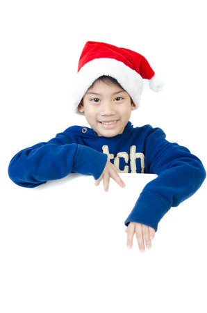 Portrait of Asian cute boy  in christmas hat with blank space for your text   photo