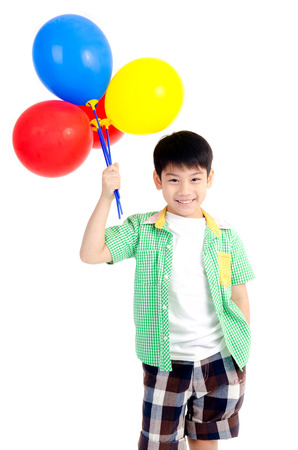 Happy asian cute boy with colorful balloons on white background    Banco de Imagens
