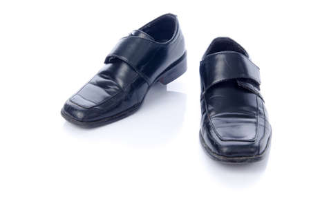 Old black shoes and shadow isolate on white. Stock Photo - 24389923