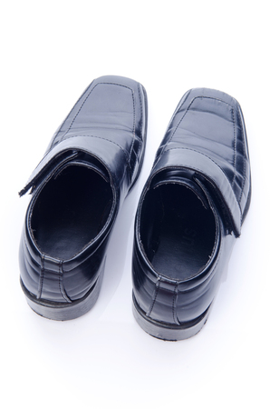 Old black shoes and shadow isolate on white. Stock Photo - 24389929