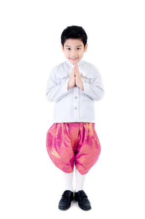 Asian cute boy in thai costume acthing Hello in thai