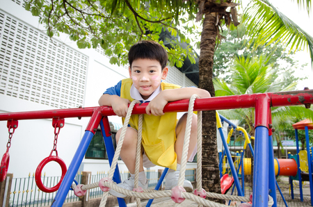 Asian cute boy playing in the park    photo