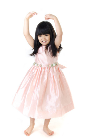 gril: Portrait of asian cute gril is dancing on Gray background    Stock Photo