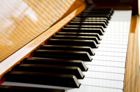 hymnal: close-up of piano keys. close frontal view