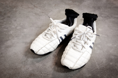 old running shoes on concrete floor background photo