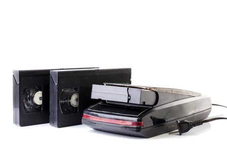superseded: Old Video Cassette and Vintage VHS Rewinder isolate on white background .  Stock Photo