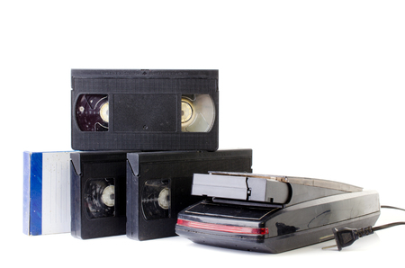 superseded: Old Video Cassette and Vintage Rewinder isolate on white background .