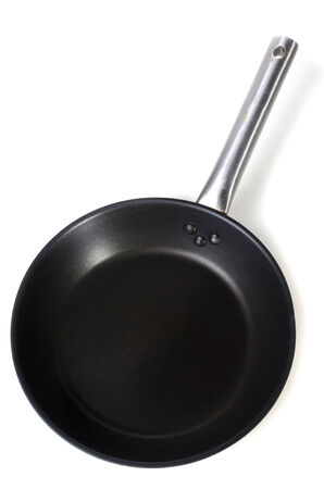 adherent: black frying pan on white background .  Stock Photo