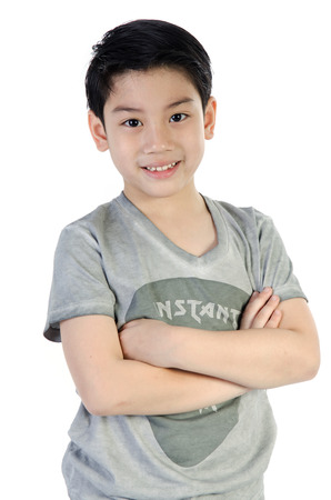 Portrait Of asian happy cute  boy on white background   Stock Photo