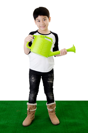 watering pot: Little Asian smile child with watering pot . Stock Photo