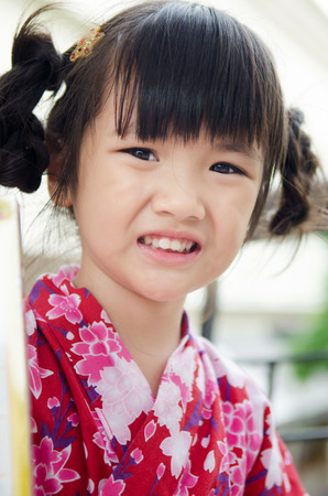 gril: Little asian child in japanese traditional costume, kimono  .