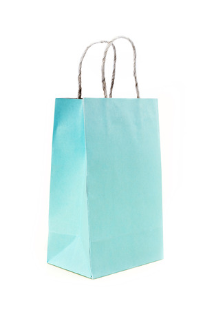 Recycled  Shoppingn blue pastel  paper bag on white background .  photo