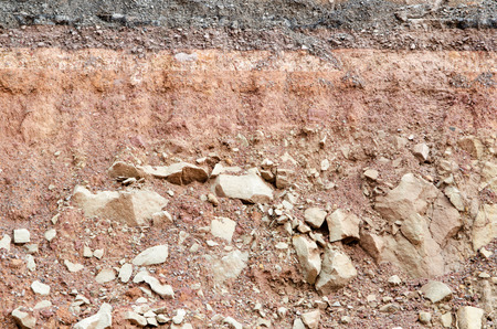 Section of asphalt road collapses.Layer of soil beneath section photo