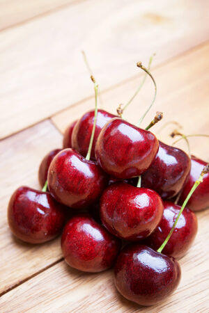 Fresh red Cherries on wooden table ,closeup macro background