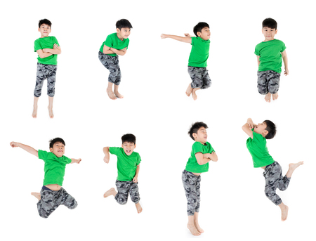 Group of Asian cute child in green shirt is jumping on white background