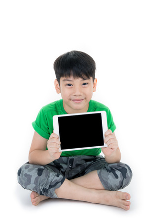 Happy Asian child with tablet computer isolate on white background.