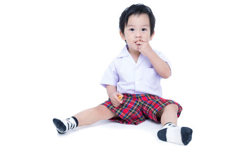 unifrom: Closeup portrait of a cute little asian child on white background . in student unifrom Stock Photo