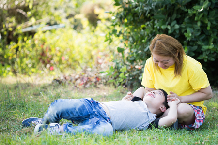 Happy asian mom with cute little boy are playing at the park Stock Photo