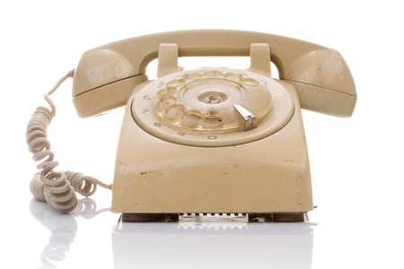 Old and dirty vintage telephone with shadows isolate on white background
