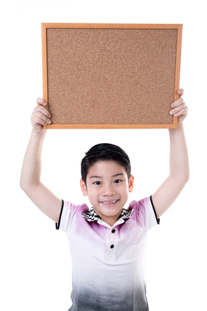 Portrait of Asian little boy hold wood board isolate on white background .